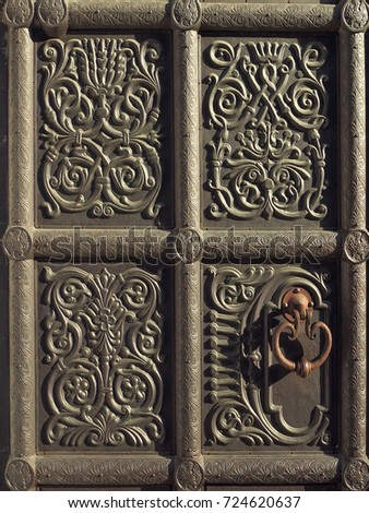 Iron antique door with handle and ornament
