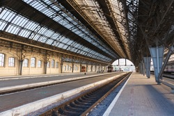 iron arches and empty platform of ancient Lviv Central Station at early morning