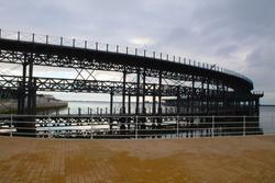 iron bridge that goes into the sea like a pier