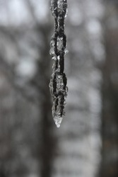 iron chain in ice outdoors