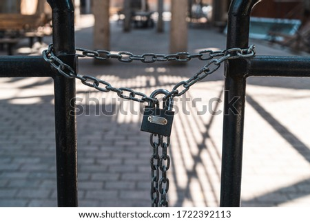 Iron chain on iron railing stock photo