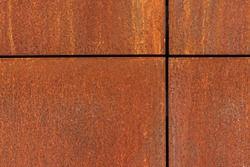 Iron corroded texture background. Rusty metal surface. Rusted metal plates with crosswise border lines.
