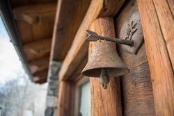 Iron doorbell in a house in Italian mountains, Valle d'Aosta