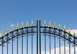 Iron fence opens and closes from the middle.