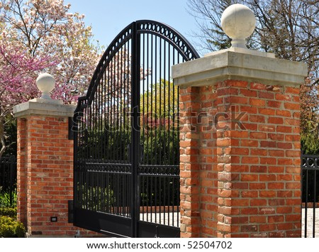 Iron gate and two masonry posts