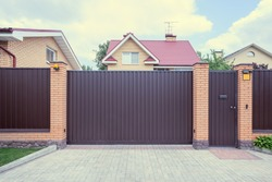 Iron gate of the luxury comfortable home.