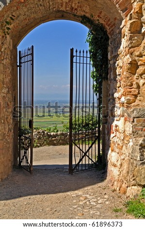 Iron gate with landscape behind