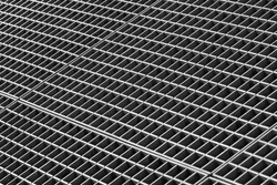 Iron gutter grates and metal vent grids as black and white industrial background