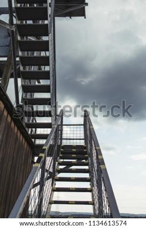 Iron ladder on industrial building Stock fotó ©