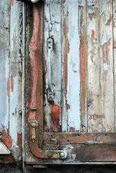 Iron Lock on Decaying Timber Door of Old Railway Wagon