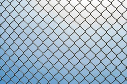 Iron net on the sky background