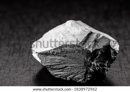 Photo of  iron ore stones, on isolated black background, used in industry, Chinese iron ore for export and import.