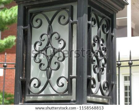 Iron ornate street lamp #1158568813