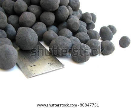 Iron pellets. Iron ore pellets are spheres of typically 8–18 mm. - stock photo