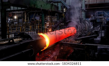 Iron pipe centrifugal pipe casting machine at the foundry Foto stock ©