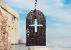 Iron plate with cross in The Monastery of the Temptation, in Jericho, Palestine. Greek Orthodox monastery. Judean desert