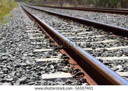iron rusty train railway detail over dark stones rail way - stock photo