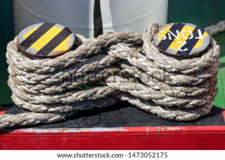 iron shipboard bitts with rope #1473052175