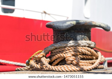 iron shoreside bollard with rope #1473051155