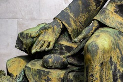 Iron statue detail of human hands