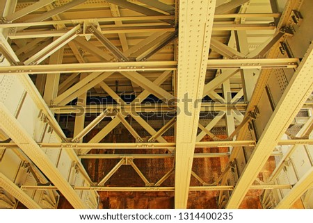 Iron Structure of the down side of the Blackfriars Railway bridge in London, UK seen from Themes Path under the bridge.It provide vertical and lateral support for the bridge #1314400235