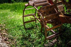 Iron wheel old walk-behind tractor for farming in Thailand.