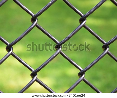 iron wire fence isolated on green background