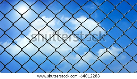 iron wire fence on blue sky background .