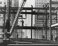 Iron workers raise steel at 32nd floor of the Esso Building in New York City. 1954.