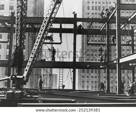Iron workers raise steel at 32nd floor of the Esso Building in New York City. 1954. stock photo