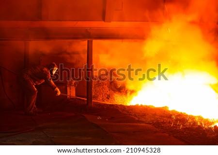 iron works blast furnace taphole spewing molten iron, closeup of photo Stock fotó ©