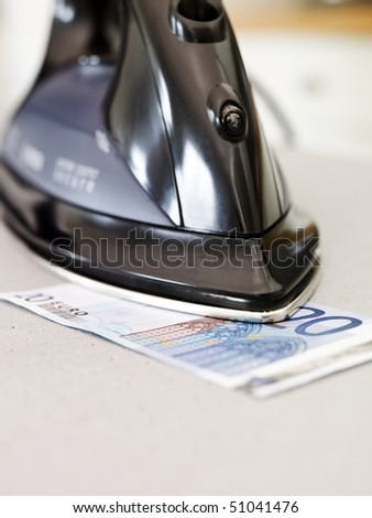 Ironing a Euro bank note #51041476
