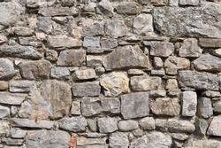 irregular natural stone wall (textured background)