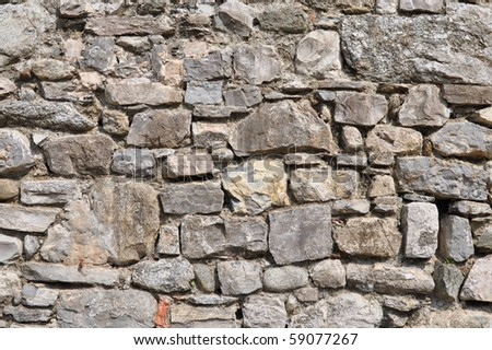 irregular natural stone wall (textured background)