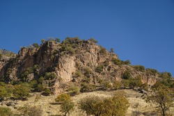 Irregular rock cliff texture and background, stone crags mountain cliff texture and background in autumn season, every green became yellow. Erbil, Kurdistan, Iraq.