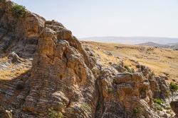 Irregular rock cliff texture and background, stone crags mountain cliff texture in summer season. Kanishok, Sulaymaniyah, Kurdistan, Iraq.
