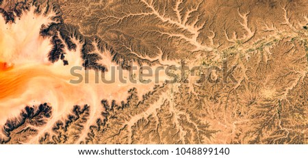 Irrigated algriculture in dried out riverbed inbetween mountains and desert, Yemen, Ararbian peninsula, natural background texture, satellite picture, contains modified Sentinel Copernicus data [2018]