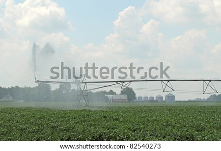 Irrigating a farm field of soy beans