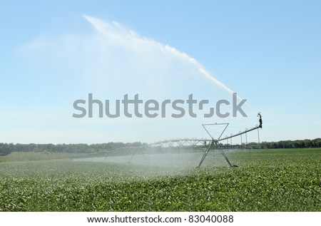 Irrigating a farm field of soybeans