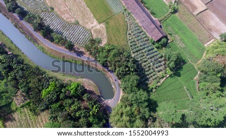 irrigation channels on agriculture. Infrastructure in agriculture. Building agricultural land. Aerial landscape in villages in Indonesia and Asia. #1552004993