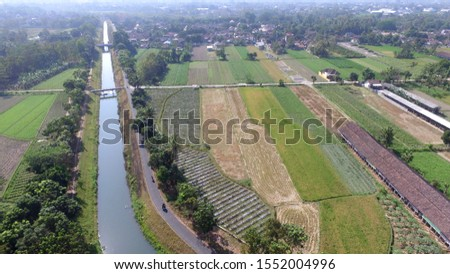 irrigation channels on agriculture. Infrastructure in agriculture. Building agricultural land. Aerial landscape in villages in Indonesia and Asia. #1552004996