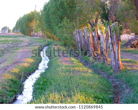 irrigation ditch and alley