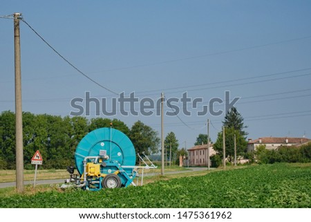 Irrigation machine for irrigation in the field in the village, long-range plan #1475361962
