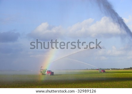 Irrigation machine waters crop on the field