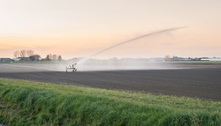 Irrigation of an agricultural field in Holland with a sprinkler system during a period of drought