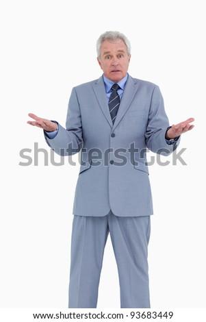 Irritated mature tradesman against a white background