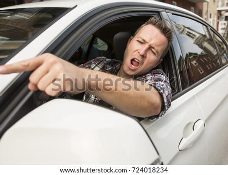 Irritated young man driving a car. Irritated driver Сток-фото ©