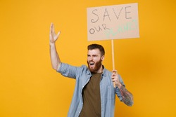Irritated young protesting man hold protest sign broadsheet placard on stick rising hand scream isolated on yellow background. Stop nature garbage ecology environment protection concept. Save planet