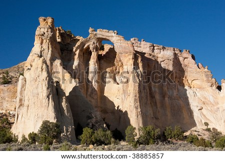 is a large, spectacular double arch at the end of a ridge of yellowish-white Henrieville sandstone, and is one of the most photographed places in the Grand Staircase-Escalante National Monument.