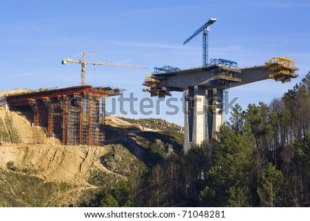 is building a concrete bridge